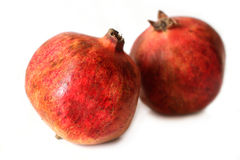 Mogen granatäpple på vit bakgrund Fotografering för Bildbyråer
