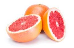Mogen grapefrukt på vit bakgrund Arkivfoton