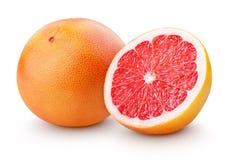 Mogen grapefruktcitrusfrukt med halva som isoleras på vit Royaltyfri Fotografi
