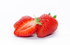 Mogen jordgubbe på en vitbakgrund Fotografering för Bildbyråer