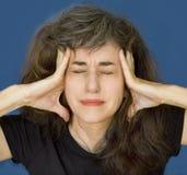 mogen kvinna för huvudvärk royaltyfria bilder