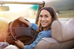 Mogen kvinna som kör bilen royaltyfria foton