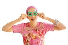 Mogen kvinna som ser till och med glidbanaramar Arkivfoto