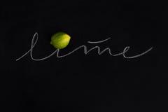 Mogen ny limefrukt med inskriften Royaltyfria Foton