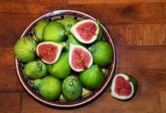 mogen sötsak för figs arkivbild