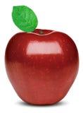 Moget rött äpple med ett grönt blad Arkivbilder