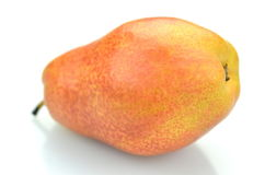 Moget saftigt päron som isoleras på vit bakgrund Fotografering för Bildbyråer