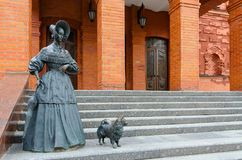 Sculptural composition Lady with Dog near regional drama theater, Mogilev, Belarus. MOGILEV, BELARUS - APRIL 23, 2015: Sculptural composition `Lady with Dog` royalty free stock images