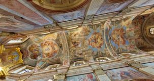 MOGILEV, BELARUS - AUGUST 2019: spinning and torsion of interior view and Looking up into a catholic church Dome with murals,  pai. Nting and stucco on walls and stock footage