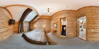 MOGILEV, BELARUS - JUNE 18, 2012: Panorama in interior stylish room in hotel in rustic wood style. Full 360 degree seamless royalty free stock photography