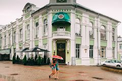 Mogilev, Belarus. People Walking On Old Street In Summer rainy D. Mogilev, Belarus - August 18, 2018: People Walking On Old Street In Summer rainy Day royalty free stock photos