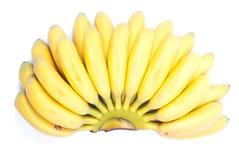Mogna gula bananer behandla som ett barn på vit isolerad bakgrund med shado Arkivbild