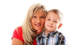 Mogna modern med barnet 6 år isolerad pojke Fotografering för Bildbyråer