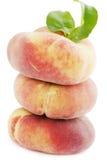 Mogna plana persikor Fotografering för Bildbyråer