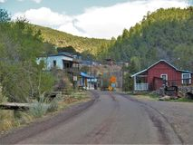 Historic Town of Mogollon, New Mexico. Mogollon is a former mining town located in the Mogollon Mountains in Catron County, New Mexico. It was founded in the stock image