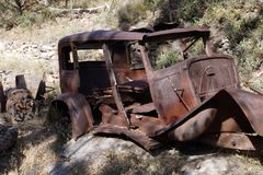 Wrecked Vintage Automobile on Rocks royalty free stock photography