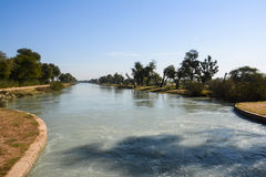 Mohajir Branch Canal. Long view of Mohajir Branch Canal – Northern Punjab Pakistan. A peaceful and unique shot taken from head bridge where Adhi Wala Nala Royalty Free Stock Photography