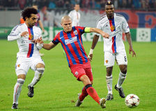 Mohamed Salah, Alexandru Bourceanu, Serey Die during Champions League game Royalty Free Stock Photography