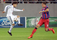 Mohamed Salah and Florin Gardos during Champions League game. Steaua's Florin Gardos and FC Basel's Mohamed Salah pictured in action during the UEFA Champions stock images