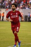 Mohamed Salah #11 of Liverpool FC in action against Manchester City during 2018 International Champions Cup game. EAST RUTHERFORD, NJ - JULY 25, 2018: Mohamed royalty free stock image