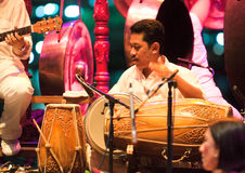 Mohammed Hussin leading Rhythm in Bronze. Mohammed Kamarulbahri Hussin, a master drummer, leading Rhythm in Bronze, a Malaysian fusion modern gamelan orchestra Stock Image