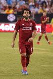 Mohammed Salah #11of Liverpool FC in action against Manchester City during 2018 International Champions Cup game. EAST RUTHERFORD, NJ - JULY 25, 2018: Mohammed royalty free stock images