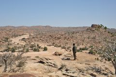 Mohammedan prayer. Somalia. LAS GIL, SOMALIA - JANUARY 9, 2010: Complex of caves with petroglyphs is the most significant monument of the epoch of the neolith in Royalty Free Stock Photography