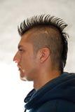 Mohawk. Profile portrait of Hispanic  man with spiked Mohawk Royalty Free Stock Photography