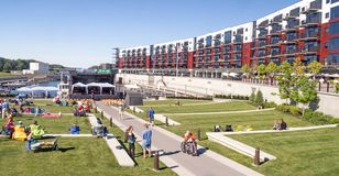 Mohawk Harbor apartments and retail. Amphitheatre Mohawk Harbor people waiting for concert, summer blue sky, Schenectady New York, luxury apartments, high-tech stock image