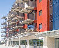 Mohawk Harbor apartments and retail. Mohawk Harbor water edge apartments and ground floor retail, summer blue sky, Schenectady New York, luxury apartments, high stock image