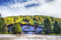 Mohawk mountain Cornwall connecticut autumn. The mohawk mountain ski building at the base of the ski slopes on a sunny autumn day in Cornwall connecticut royalty free stock image
