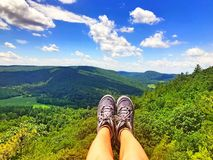 Mohawk trail mountain top. A asian young woman sitting on the mohawk trail top of mountains in Connecticut United states Royalty Free Stock Photography