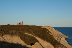 Mohegan Bluffs and the Southeast Lighthouse on Blo. Ck Island, Rhode Island Stock Photography