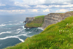 Moher cliffs clouds and meadows Royalty Free Stock Photo