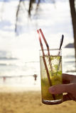 Mohito cocktail with sun flare at the beach Royalty Free Stock Photos