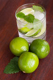 Mohito cocktail surrounded by limes Stock Image