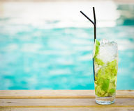 Mohito mojito drink with ice mint lime near swimming pool. Mohito mojito drink with ice mint and lime near swimming pool stock image