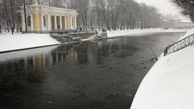 Moika river during a snowfall. View of the Moika River during a snowfall, St. Petersburg, Russia stock footage