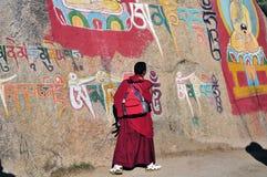 Moine et Bouddha, Thibet image stock