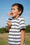 Moinho de vento de sopro do menino Foto de Stock Royalty Free