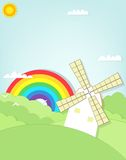 Moinho de vento dos desenhos animados no campo de grama Fotografia de Stock