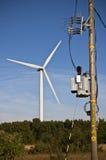 Moinho de vento e subestação elétrica Fotos de Stock