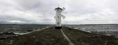 Moinho de vento na costa Imagens de Stock Royalty Free