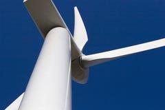 Moinho de vento no céu azul Fotografia de Stock Royalty Free