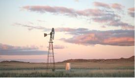 Moinho de vento no Karoo após o por do sol Foto de Stock Royalty Free