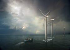 Moinho de vento no oceano Imagens de Stock