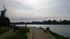 Moinho de vento pelo rio Foto de Stock Royalty Free