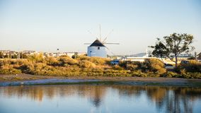 Moinho de vento perto do rio Foto de Stock Royalty Free
