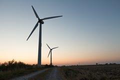 Moinhos de vento e um caminho Foto de Stock Royalty Free