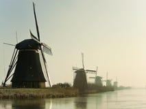 Moinhos de vento holandeses tradicionais no alvorecer Fotos de Stock Royalty Free